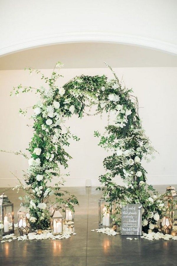 elegant greenery wedding arch ideas with lanterns