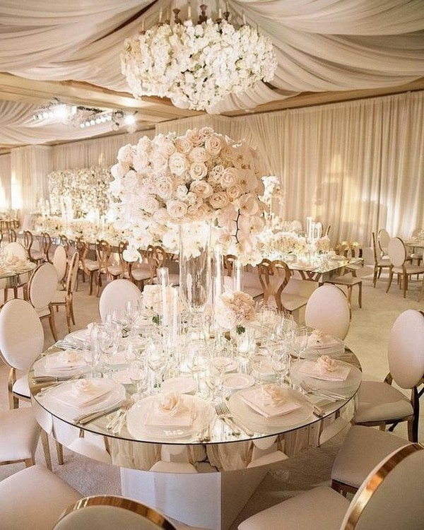 elegant pink and gold wedding reception with tall centerpiece