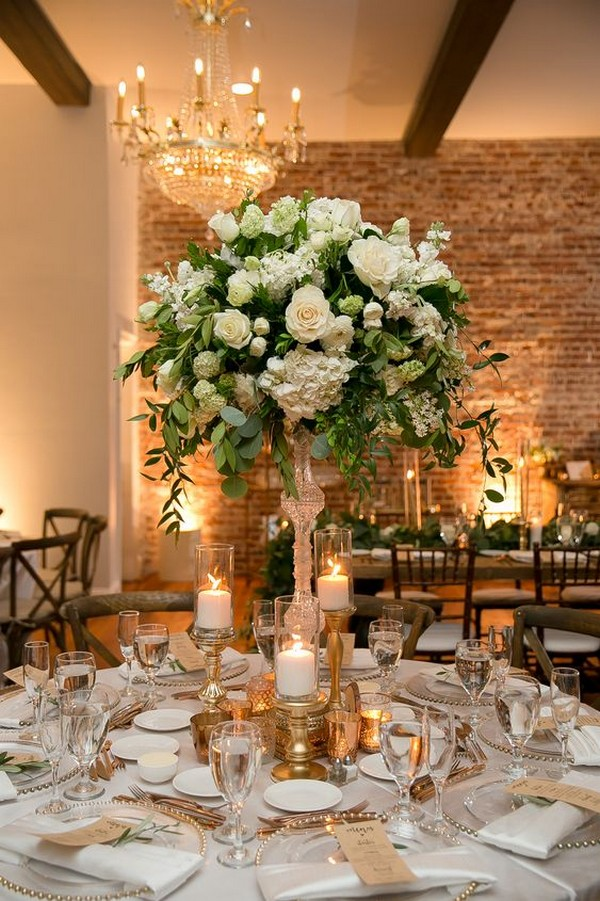 elegant wedding reception setting with tall centerpiece