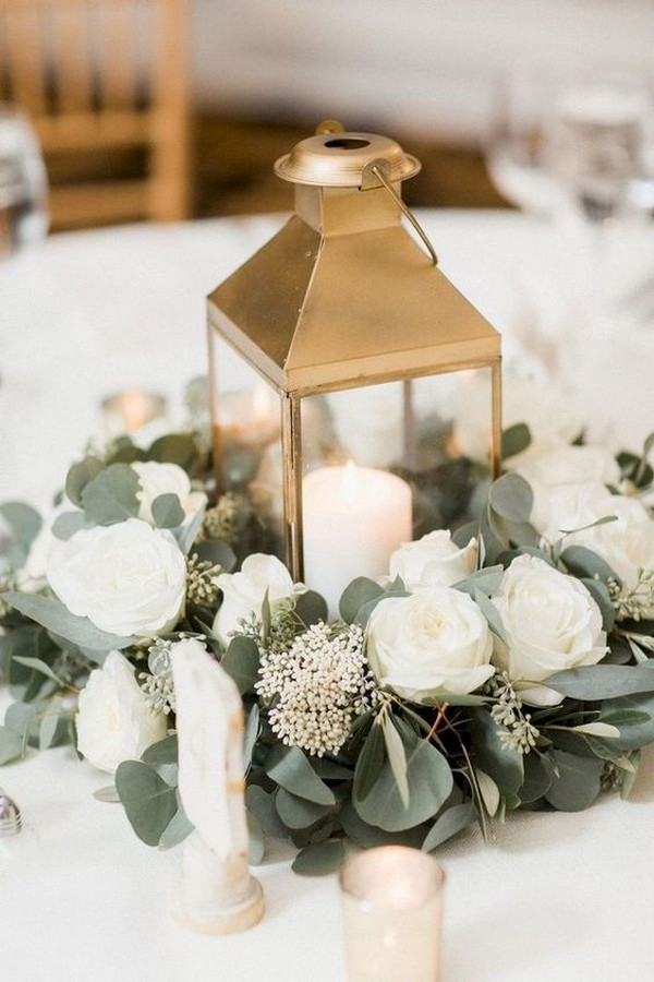 gold lantern and eucalyptus wedding centerpiece
