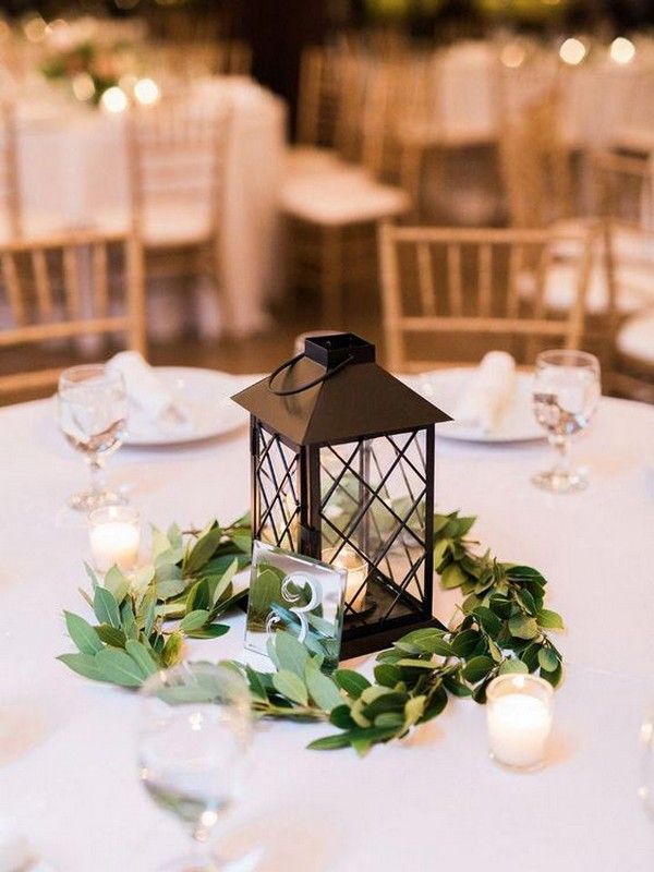 lattice lantern wedding centerpiece with greenery
