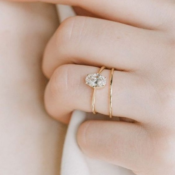 simple and delicate oval diamond engagement ring