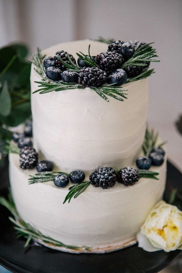 simple elegant winter wedding cake with berries