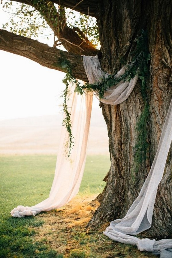 simple wedding backdrop ideas with drapery and greenery