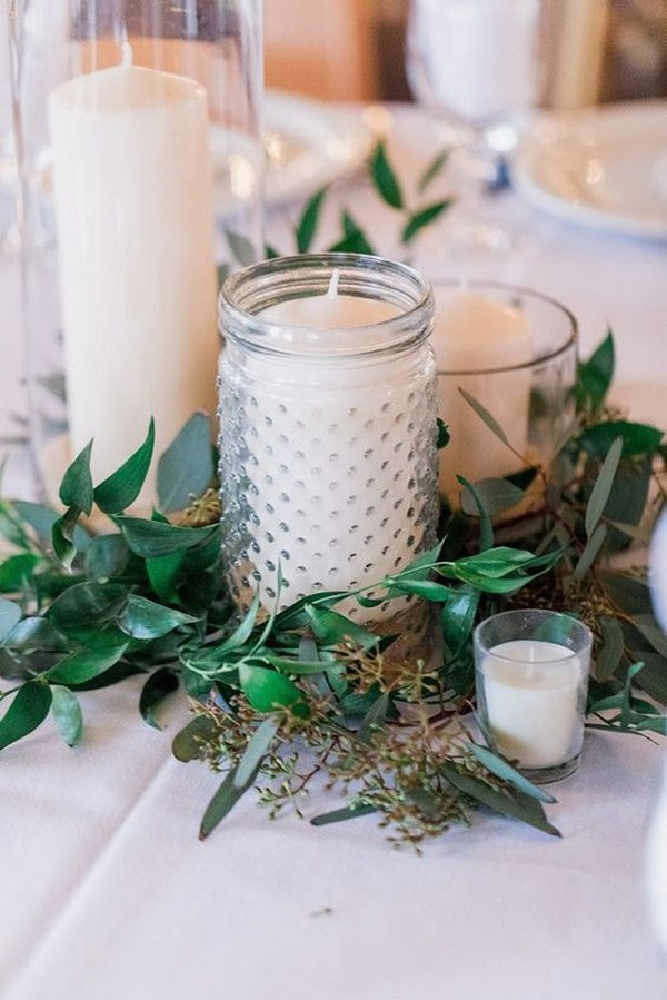 winter wedding centerpiece ideas with candles and greenery