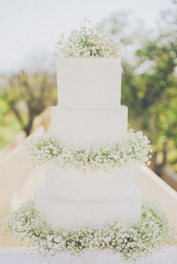 all white wedding cake with baby's breath