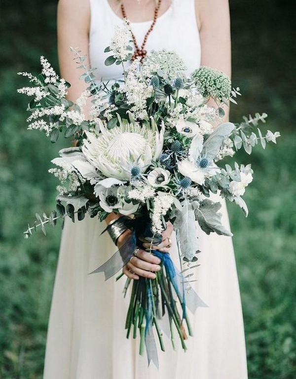 blue and green wedding bouquet with white protea