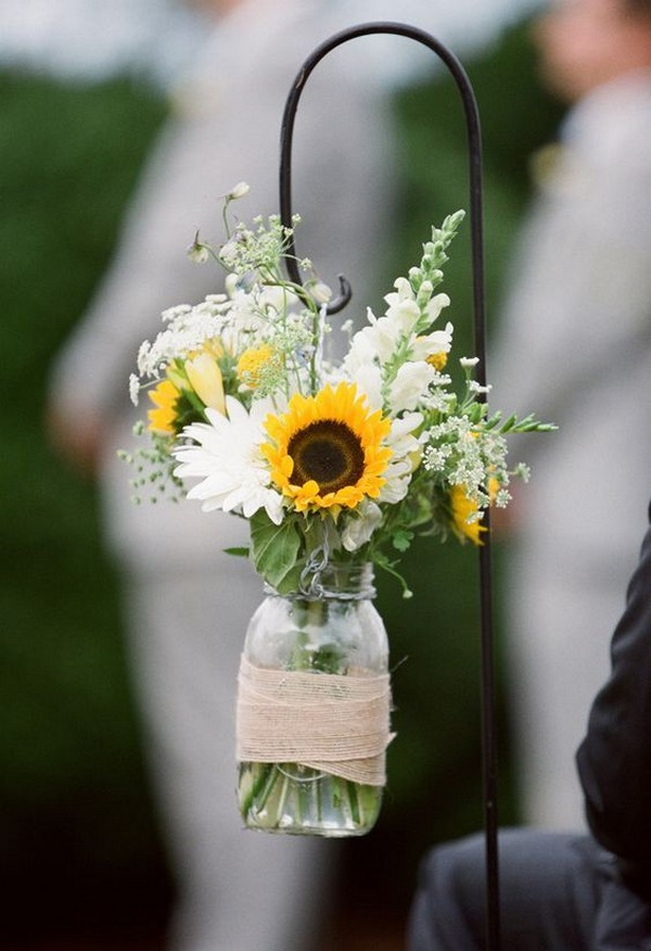 chic wedding aisle decorations with mason jars and sunflowers