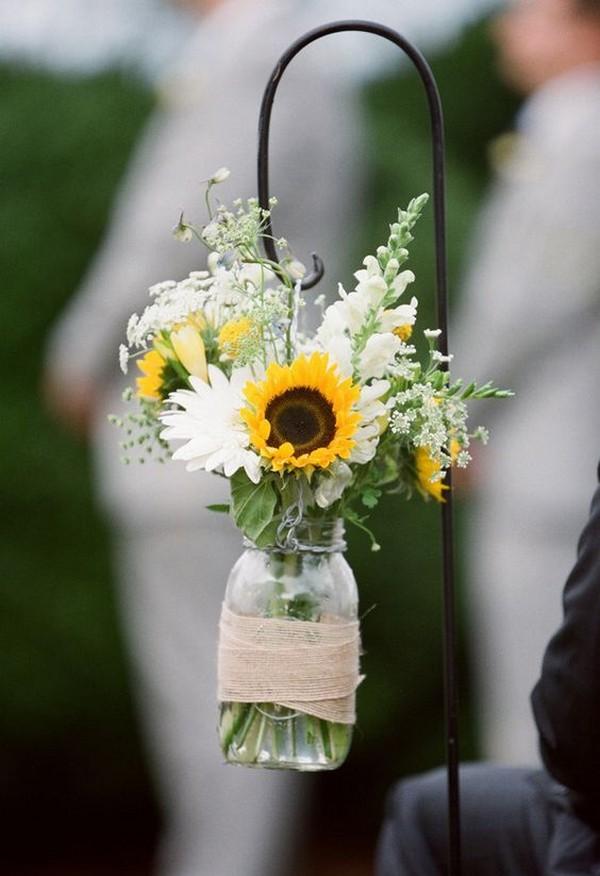 chic wedding aisle decorations with mason jars and sunflowers