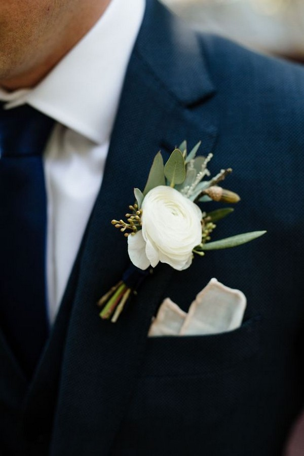 classic navy blue groom suit with white boutonniere