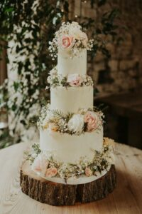country rustic wedding cake decorated with flowers