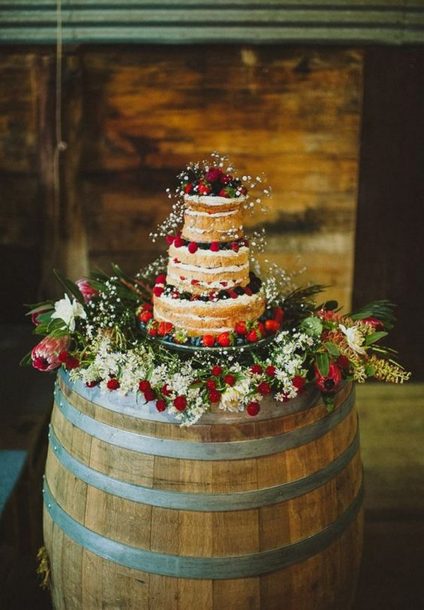 country wedding cake ideas with wine barrel stand