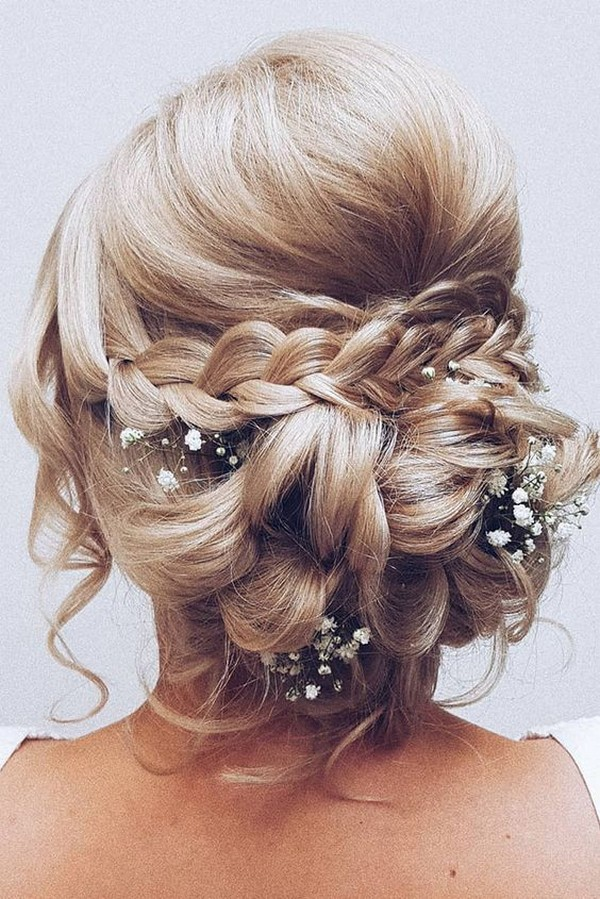 low bun wedding hairstyle with baby's breath