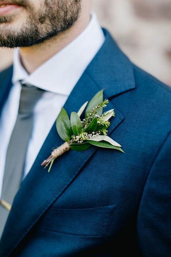 navy blue groom's suit with greenery boutonniere