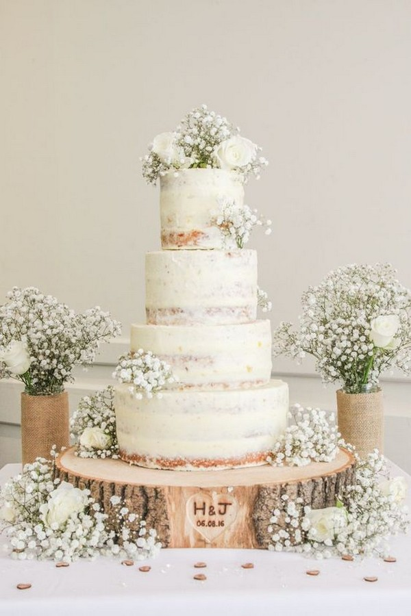 semi naked rustic wedding cake with baby's breath