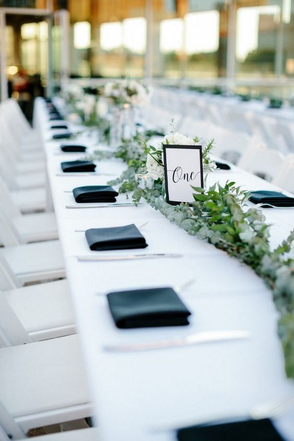 simple navy blue white and greenery wedding table settings