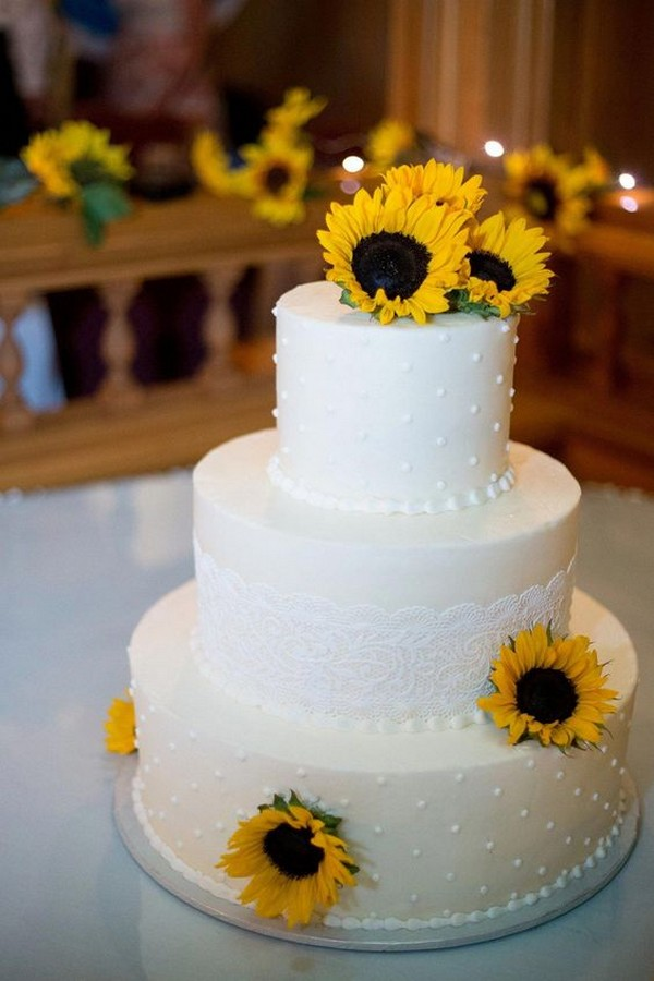 simple wedding cake with sunflowers