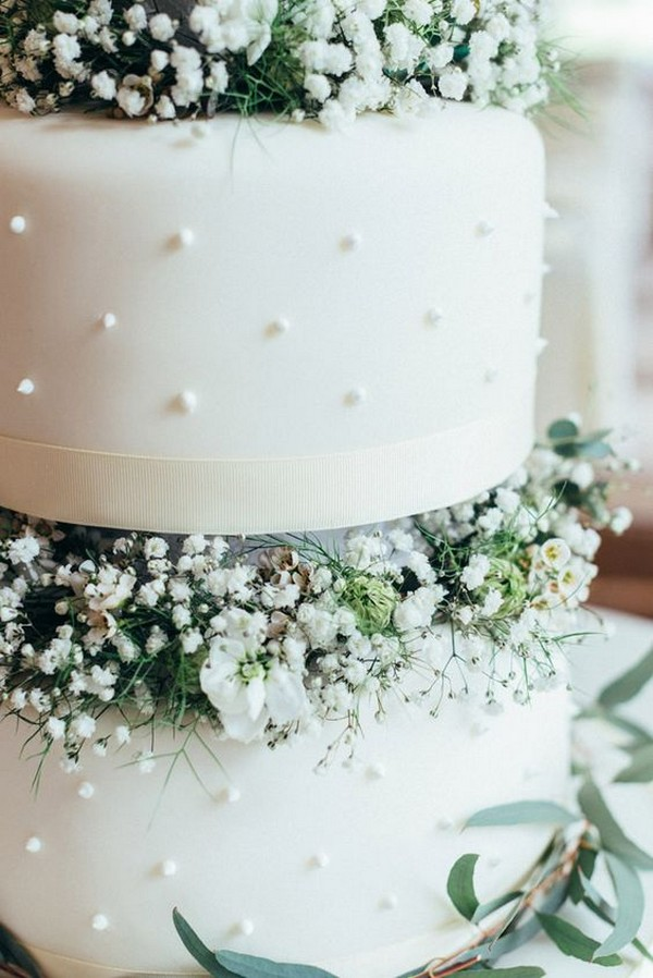 white wedding cake with baby's breath