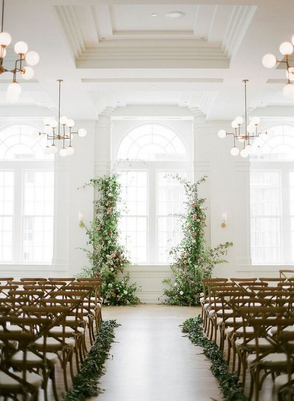 chic simple indoor wedding ceremony ideas with floral backdrop