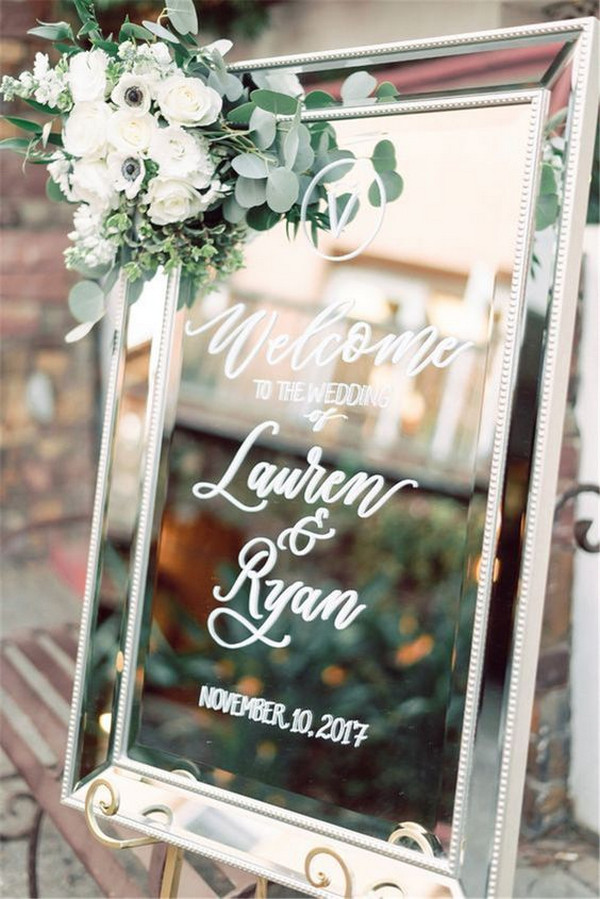 eleagnt mirror and greenery wedding welcome sign