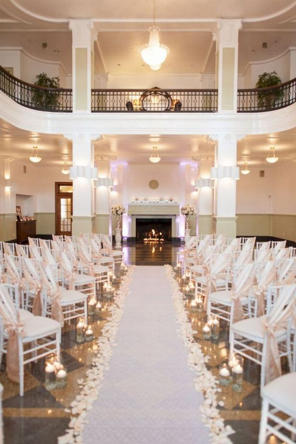 elegant white and blush wedding ceremony decoratio