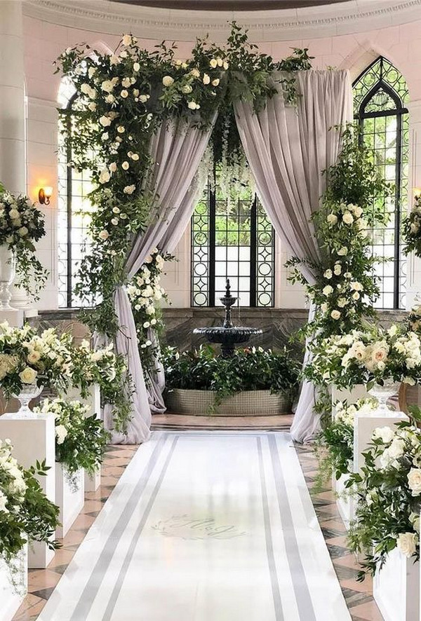 indoor wedding ceremony ideas with lush blooms