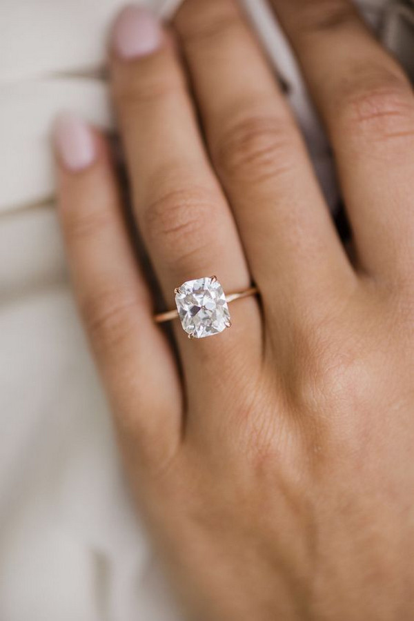 simple rose gold engagement ring with cushion cut diamond