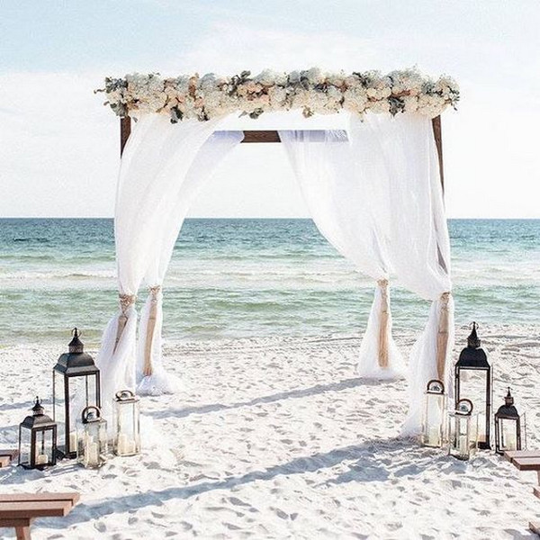 beach wedding alter ideas with lanterns
