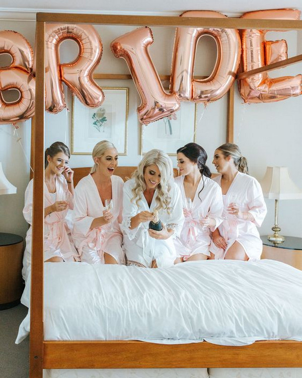 bridal party wedding photo ideas with rose gold decorations