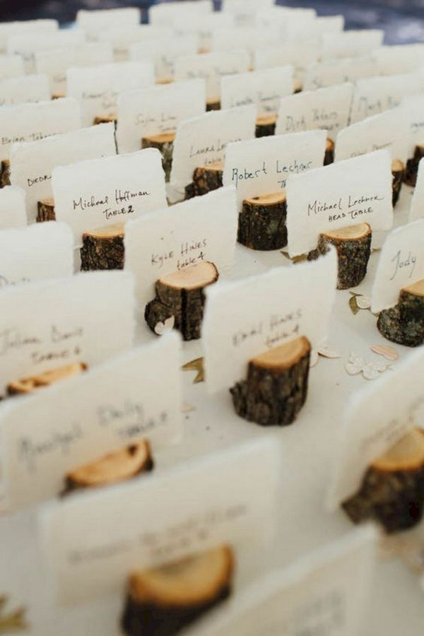 country wedding table number ideas with tree stumps