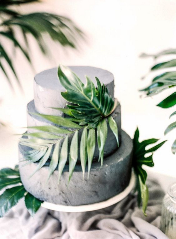 gray wedding cake with palm leaves