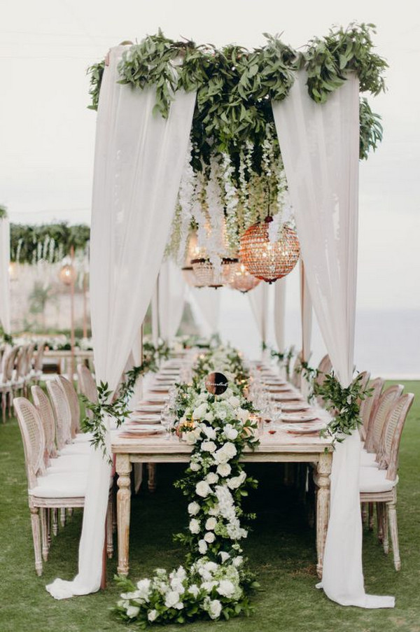 stunning white and greenery beach wedding reception