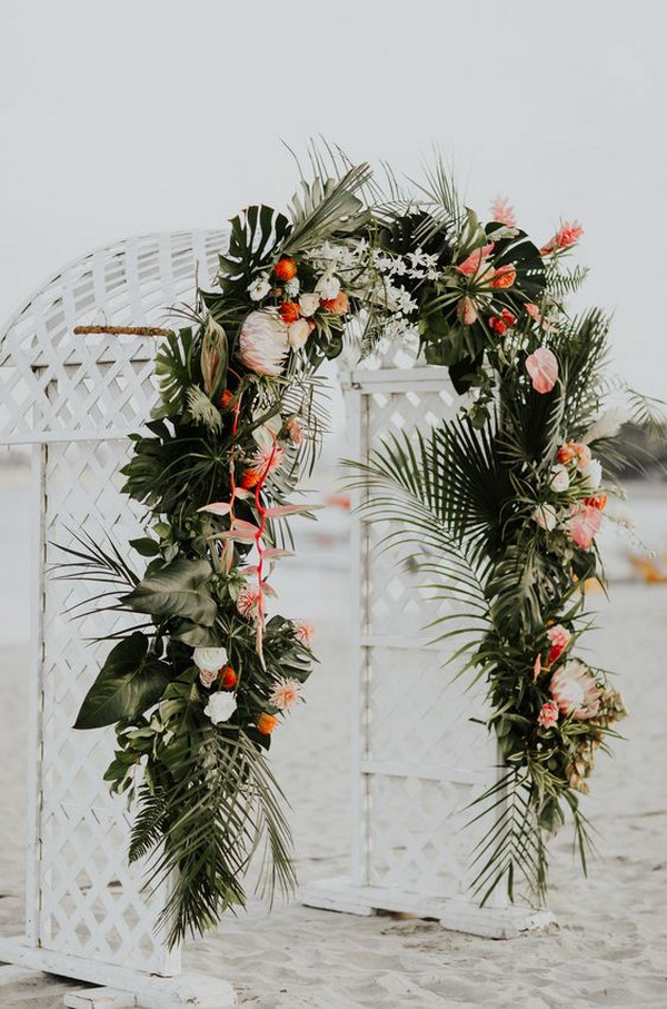 tropical wedding arch ideas with palms and floral