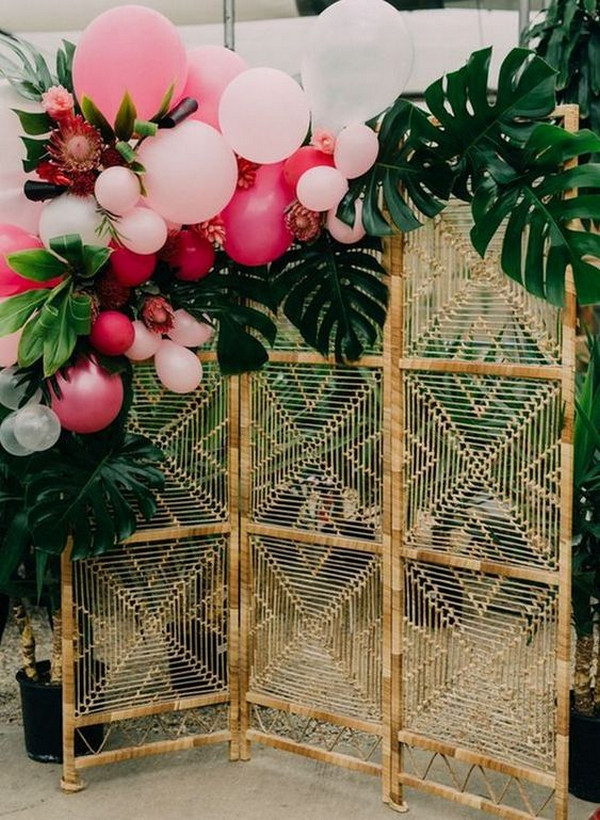 tropical wedding backdrop ideas with greenery and balloons