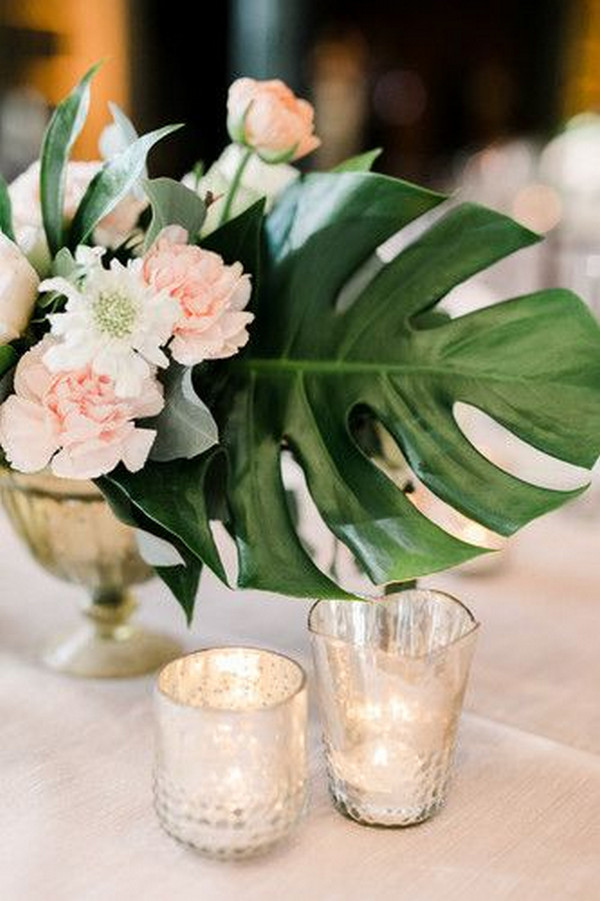 tropical wedding centerpiece with pink floral