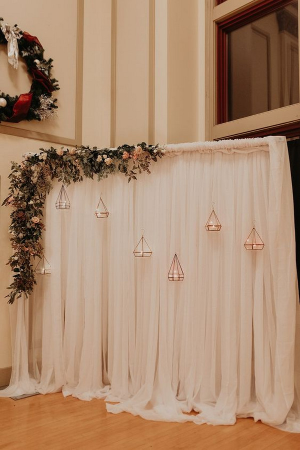wedding backdrop ideas with rose gold terrariums