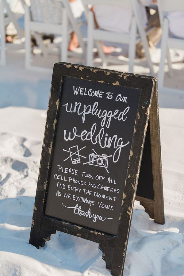 Unplugged wedding sign at a beach wedding