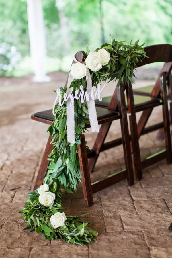 wedding reserved sign with greenery garland for ceremony