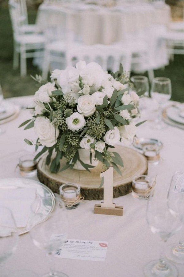 chic white and green wedding centerpiece ideas with tree stump