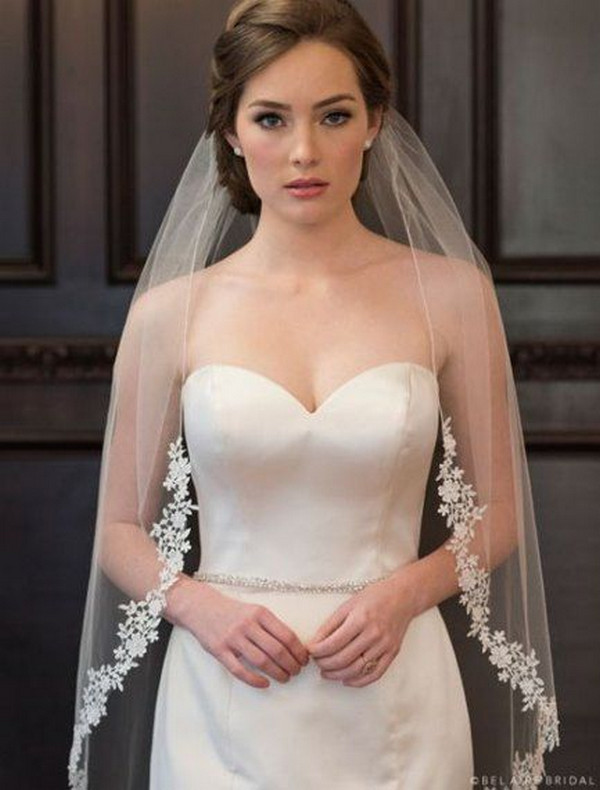 elegant updo wedding hairstyle with lace veil