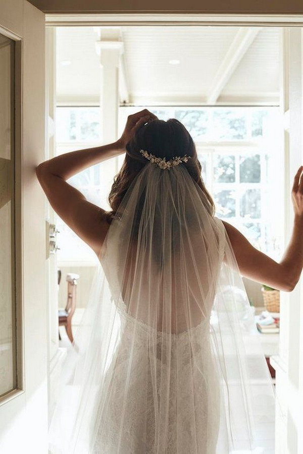 half up half down wedding hairstyle with veil and accessory