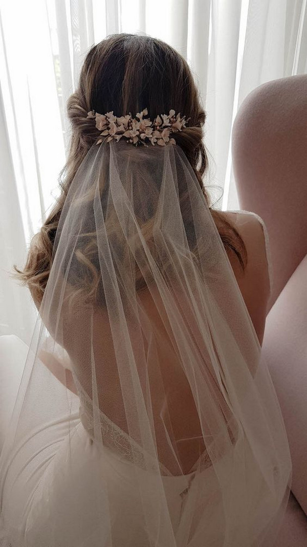 half up half down wedding hairstyle with veil