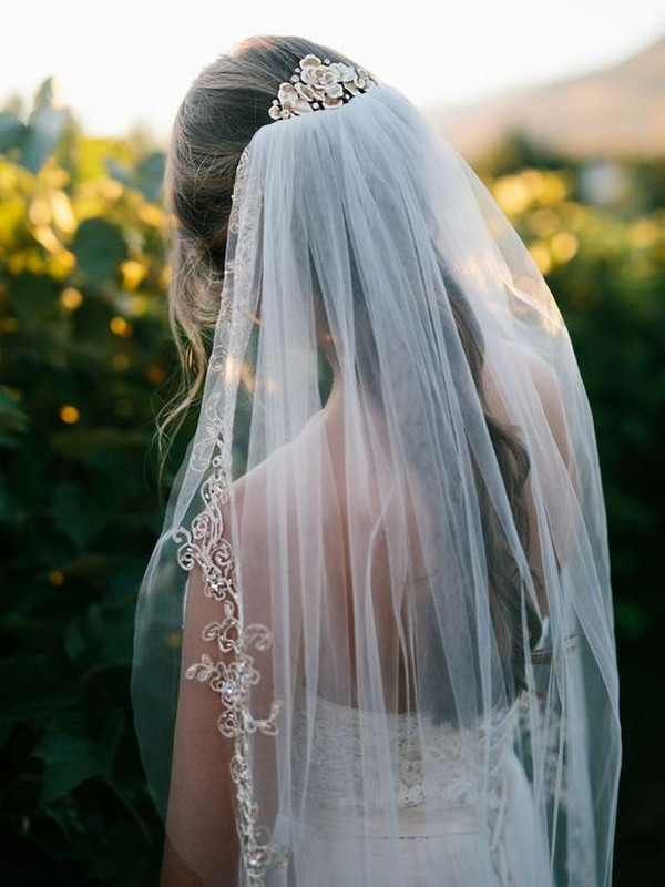 long wedding hairstlye with beaded veil