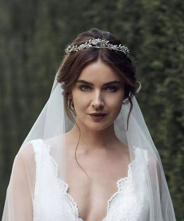 updo wedding hairstyle with veil and accessory