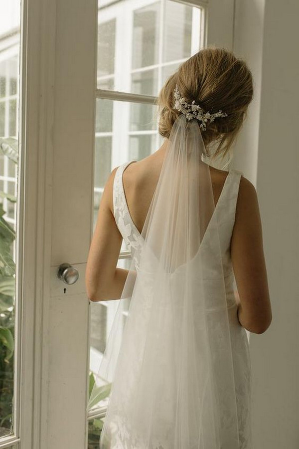 updo wedding hairstyle with veils and accessories