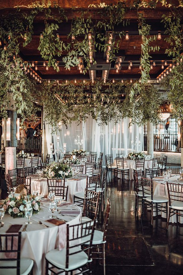 gorgeous wedding reception decorations with lights and floral ceiling