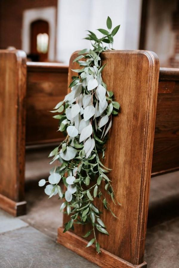 elegant greenery decorated church wedding aisle