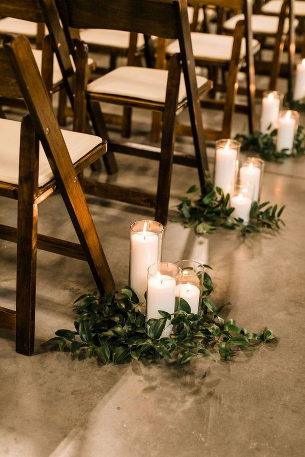chic rustic wedding aisle decoration ideas with greenery and candles
