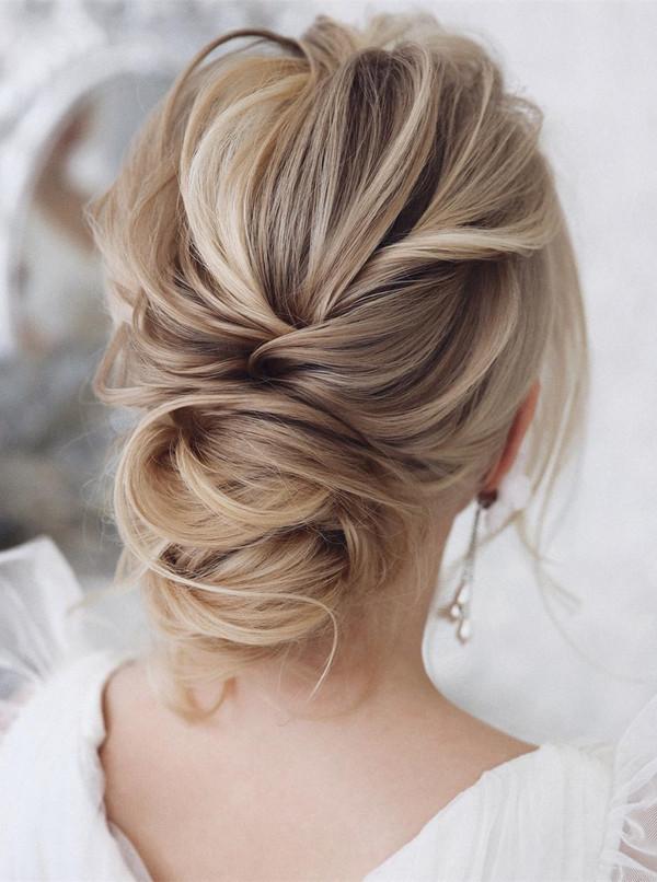 elegant updo wedding hairstyles for 2020 brides 5