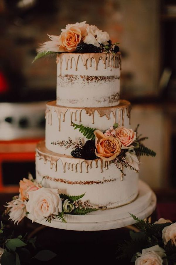 semi naked dripped wedding cake with florals